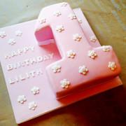 Pink first birthday cake