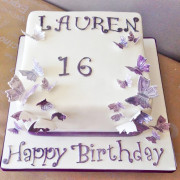 White and lilac 16th birthday butterfly wings cake