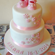 White and pink cake for new born girl